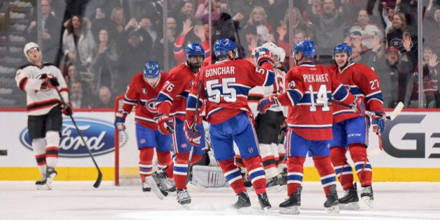 MONTREAL, QC - FEBRUARY 7: Tomas Plekanec #14 of the Montreal Canadiens celebrate with teammates after...