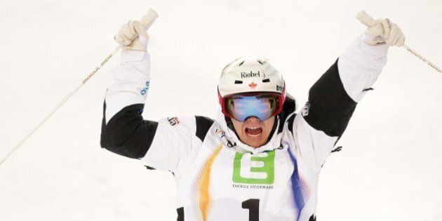 Canada's Mikael Kingsbury reacts after winning the Men's Dual Moguls final of FIS Freestyle and Snowboarding...