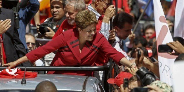 The Brazilian President and presidential candidate for the Workers' Party (PT) Dilma Rousseff greets...