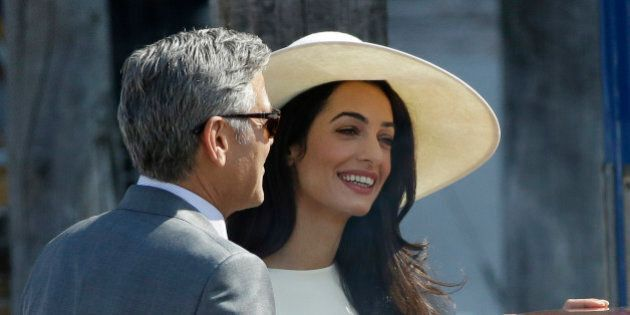 George Clooney and Amal Alamuddin leave Venice's city hall, Italy, Monday, Sept. 29, 2014. Clooney and...