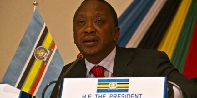 Kenyas president Uhuru Kenyatta attends the signing of the third important pillar of integration, East...