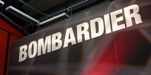 A Bombardier logo sits on a presentation platform at Bombardier Inc.'s Litchurch Lane railcar factory...