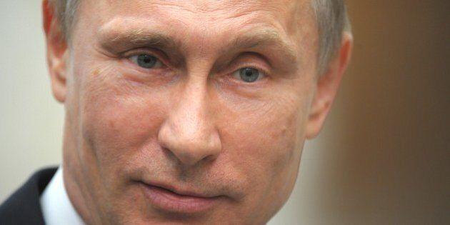 Russia's President Vladimir Putin speaks to journalists in the Belarus capital Minsk, on April 29, 2014,...