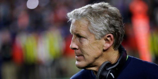 Seattle Seahawks head coach Pete Carroll watches from the sidelines during the second half of NFL Super...
