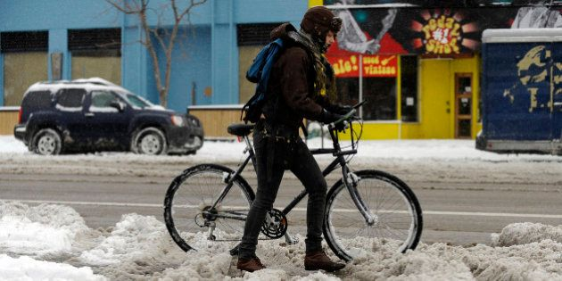 Brittany McDaniel, 21, is heading to a grocery store by pushing her bicycle near the corner of Alameda...