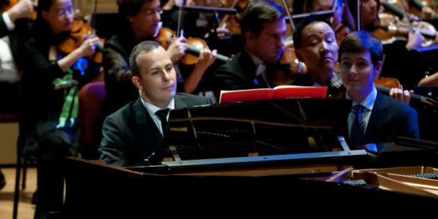 PHILADELPHIA, PA - JANUARY 26: Philadelphia Orchestra Music Director Yannick Nézet-Séguin performs...
