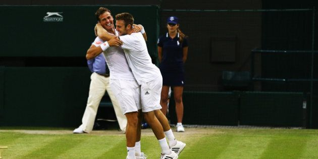 LONDON, ENGLAND - JULY 05:  Vasek Pospisil of Canada (l) and Jack Sock of the United States celebrate after winning the Gentlemen's Doubles Final against Bob Bryan and Mike Bryan of the United States on day twelve of the Wimbledon Lawn Tennis Championships at the All England Lawn Tennis and Croquet Club on July 5, 2014 in London, England.  (Photo by Al Bello/Getty Images)