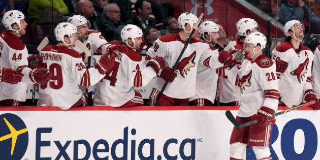 MONTREAL, QC - FEBRUARY 1: Lauri Korpikoski #28 of the Phoenix Coyotes celebrates with the bench after...