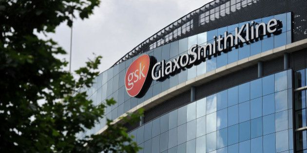 The headquarters of pharmaceutical company GlaxoSmithKline is pictured in west London on July 29, 2013....