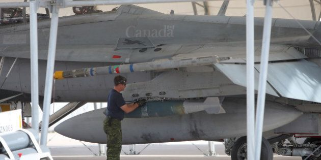 EL CENTRO, CA - NOVEMBER 4: Weapons are loaded onto a CF-18 Hornet fighter jet belonging to the Canadian...