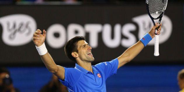MELBOURNE, AUSTRALIA - FEBRUARY 01: Novak Djokovic of Serbia celebrates winning championship point in...