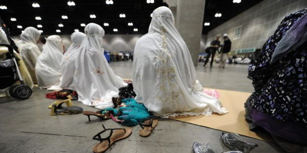 Muslim women participate in the Eid Ul Fitr prayer on September 10, 2010 at the Los Angeles Convention...