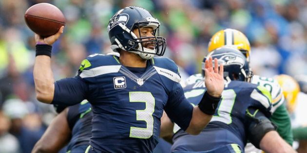 SEATTLE, WA - JANUARY 18: Quarterback Russell Wilson #3 of the Seattle Seahawks throws a pass during...