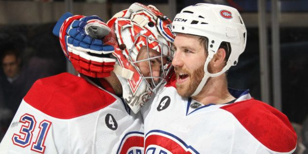 NEW YORK, NY - JANUARY 29: Carey Price #31 and Brandon Prust #8 of the Montreal Canadiens celebrate after...