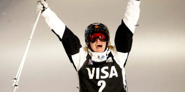 Justine Dufour-Lapointe, of Canada, celebrates after winning the women's freestyle skiing World Cup dual...