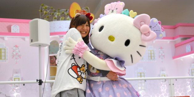 TAMA, JAPAN - NOVEMBER 01: (CHINA OUT, SOUTH KOREA OUT) Hello Kitty and a guest hug during the hug with...