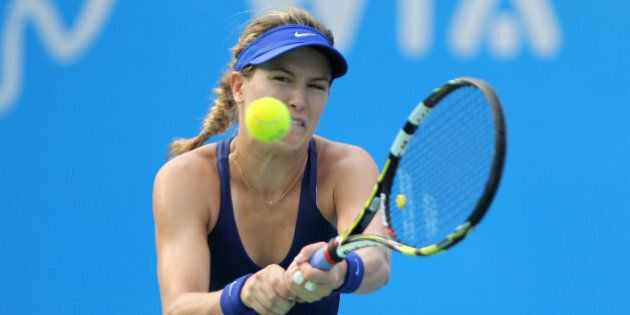 WUHAN, CHINA - SEPTEMBER 27: Eugenie Bouchard of Canada returns a shot during her final match against...