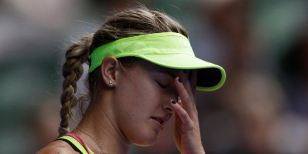 Eugenie Bouchard of Canada reacts as she plays Maria Sharapova of Russia during their quarterfinal match...