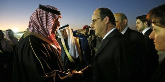 French President Francois Hollande (R) is welcomed by the Governor of the Riyadh Province, Turki bin...
