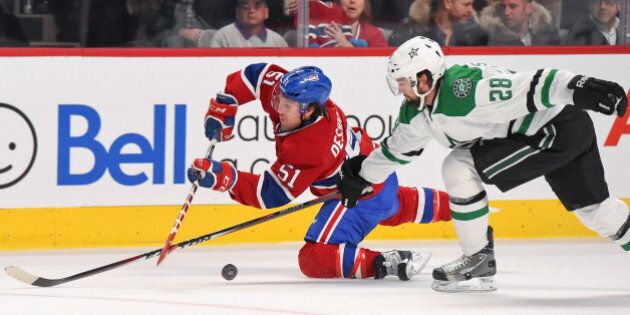MONTREAL, QC - JANUARY 27: David Desharnais #51 of the Montreal Canadiens fights for the puck against...