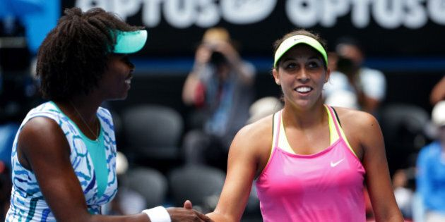Madison Keys of the U.S., right, is congratulated by her compatriot Venus Williams at the net after winning...
