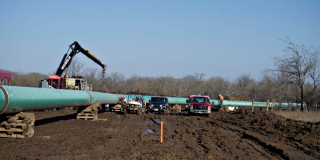 Equipment sits near a section of pipeline during construction of the Gulf Coast Project pipeline in Atoka,...