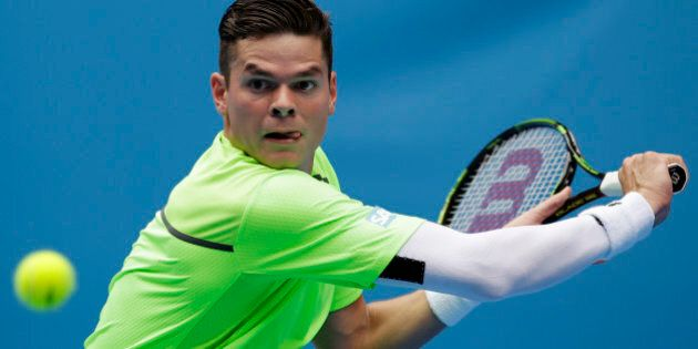 Milos Raonic of Canada eyes on the ball for a shot to Illya Marchenko of Ukraine during their first round...