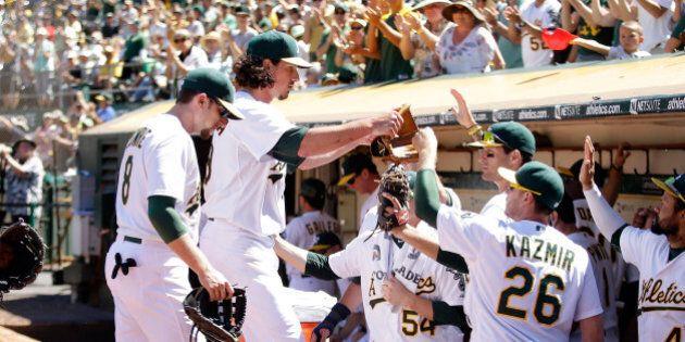 OAKLAND, CA - JULY 06: Jeff Samardzija #29 of the Oakland Athletics is congratulated by teammates after...