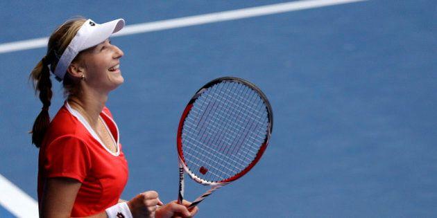 Ekaterina Makarova of Russia celebrates after defeating Simona Halep of Romania in their quarterfinal...