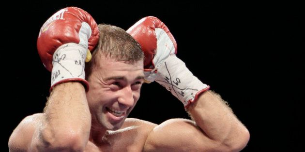 IBF Super Middleweight champion Lucian Bute of Canada reacts after knocking out Jean-Paul Mendy of France...