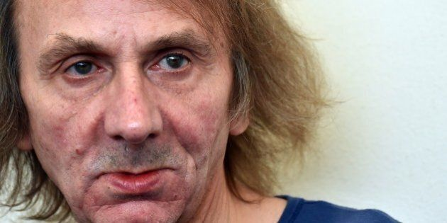 French writer Michel Houellebecq poses during the photocall of the movie 'Near Death Experience' presented...