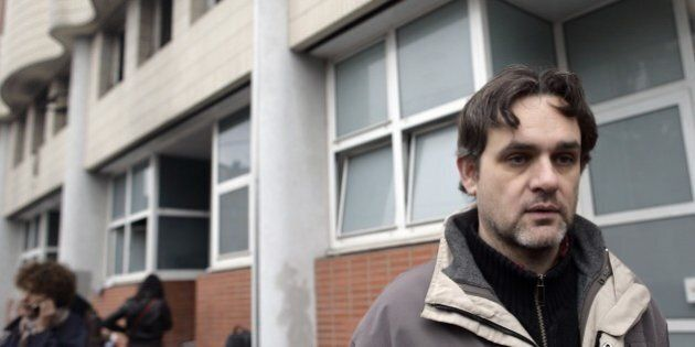 The Charlie Hebdo's cartoonist Riss is seen in front of the offices of French satirical magazine Charlie...