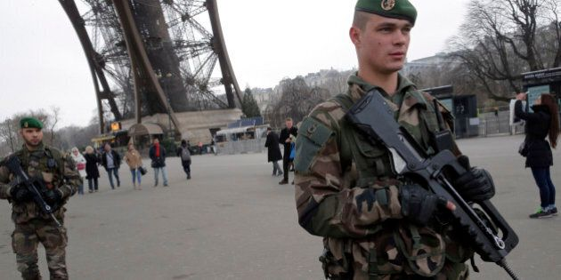 FILE - In this Wednesday Jan. 7, 2015, file photo, French soldiers patrol at the Eiffel Tower after a...