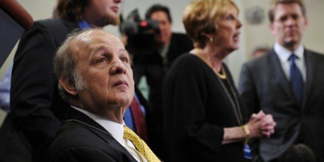 Former White House press secretary James Brady, his son Scott (behind Brady), and his wife Sarah visit the Brady Briefing Room at the White House March 30, 2011 in Washington, DC. Brady was left confined to a wheelchair in the attempted assassination of US president Ronald Reagan 30 years ago.  AFP PHOTO/Mandel NGAN (Photo credit should read MANDEL NGAN/AFP/Getty Images)