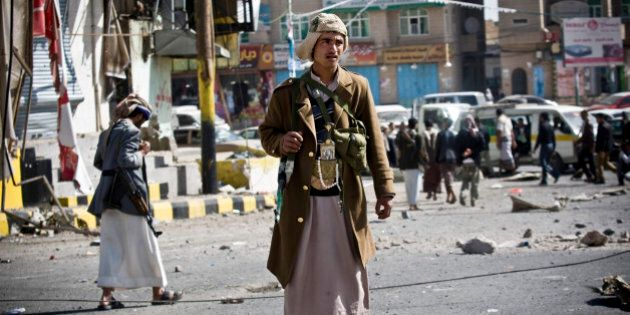 Houthi Shiite Yemeni gather while guarding a street leading to the presidential palace in Sanaa, Yemen,...