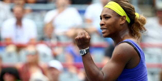 MONTREAL, QC - AUGUST 08: Serena Williams of the USA reacts after a point against Caroline Wozniacki...