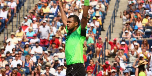 TORONTO, ON - AUGUST 08: Jo-Wilfried Tsonga of France celebrates his quarterfinals win against Andy Murray...