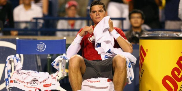 TORONTO, ON - AUGUST 08:  Milos Raonic of Canada rests between games against Feliciano Lopez of Spain in the quarterfinals during Rogers Cup at Rexall Centre at York University on August 8, 2014 in Toronto, Canada.  (Photo by Ronald Martinez/Getty Images)