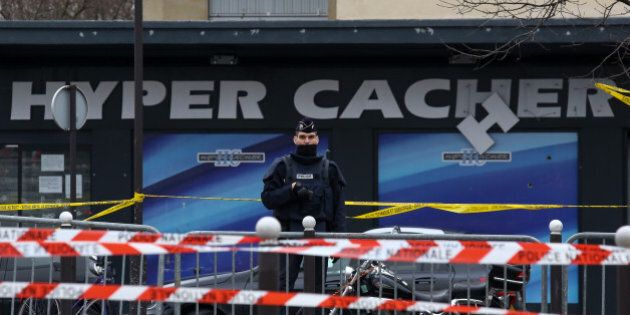PARIS, FRANCE - JANUARY 10: Police officers guard the kosher market 'Hyper Cacher', which suffered a...