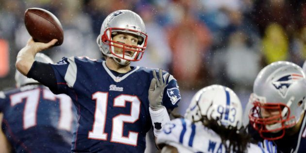 New England Patriots quarterback Tom Brady (12) passes against the Indianapolis Colts during the second...