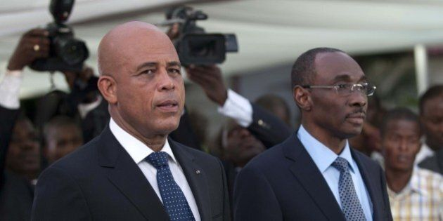 Haitian President Michel Martelly (L) stands with Prime Minister Evans Paul before the speech to the...