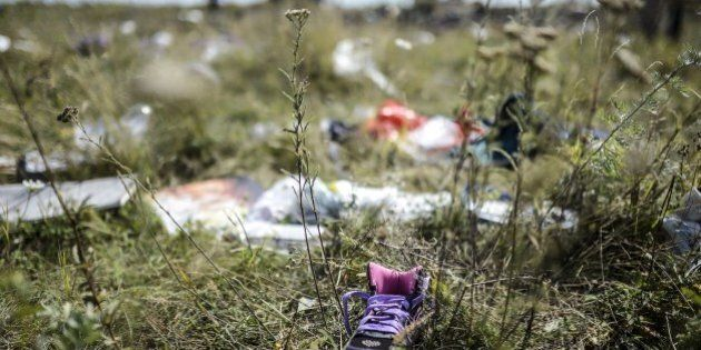Belongings of victims are pictured at the crash site of the Malaysia Airlines flight MH17 in a field...