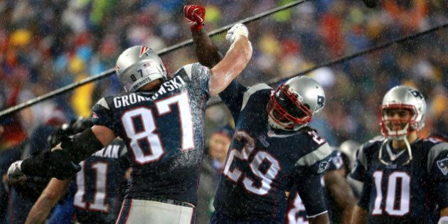 FOXBOROUGH, MA - JANUARY 18: Rob Gronkowski celebrates with LeGarrette Blunt after Gronkowski scores a touchdown in the third quarter at Gillette Stadium Sunday, January 18, 2015. AFC Championship Game between the New England Patriots and the Indianapolis Colts. (Photo by Jim Davis/The Boston Globe via Getty Images)