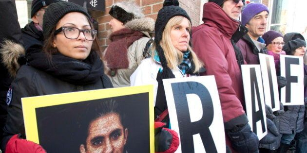Ensaf Haidar, left, wife of blogger Raif Badawi, takes part in a rally for his freedom, Tuesday, January...