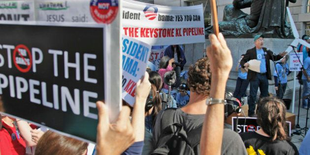 Mike Tidwell, from the Chesapeake Climate Action Network (CCAN), right, addresses a rally outside the Ronald Reagan Building in Washington, Friday, Oct., 7, 2011, against the proposed Keystone XL pipeline. The group is hoping to raise concern on the controversial proposed pipeline by Canadian company TransCanada which would bring as much as 900,000 barrels per day to the US. (AP Photo/Pablo Martinez Monsivais)