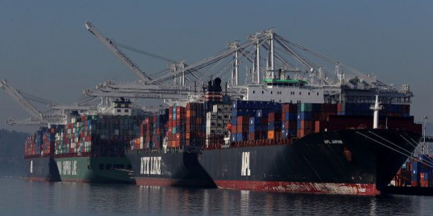 OAKLAND, CA - JANUARY 07: Container ships are seen docked at the Port of Oakland on January 7, 2015 in...