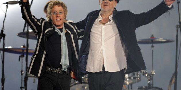 Roger Daltrey (L) and Pete Townshend of the British rock band 'The Who' perform during the halftime show...