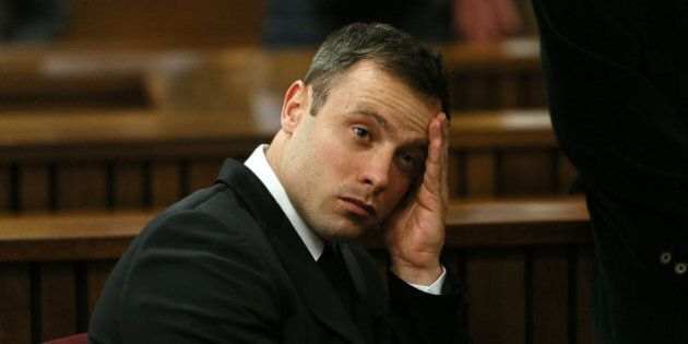 Oscar Pistorius, gestures, at the end of the fourth day of sentencing proceedings in the high court in...