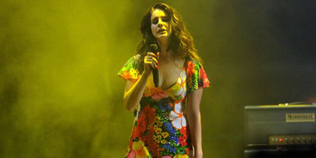 INDIO, CA - APRIL 20:  Singer/songwriter Lana Del Rey performs onstage during day 3 of the 2014 Coachella Valley Music & Arts Festival at the Empire Polo Club on April 20, 2014 in Indio, California.  (Photo by Kevin Winter/Getty Images for Coachella)