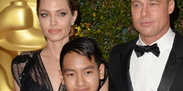 Actress Angelina Jolie, Maddox Jolie-Pitt (C) and actor Brad Pitt arrive for the 2013 Governors Awards,...